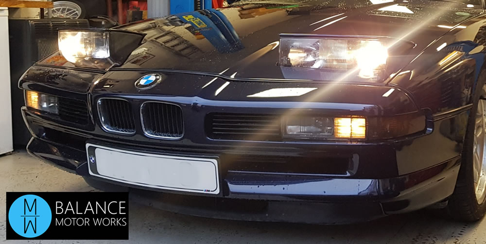BMW 840Ci Supersprint Exhaust Fitting - front end shot showing the pop up headlamps - 90's style at it's best.